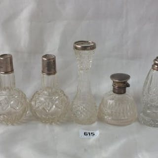 Five various scent bottles with glass bodies