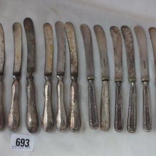 Twelve silver handled tea knives
