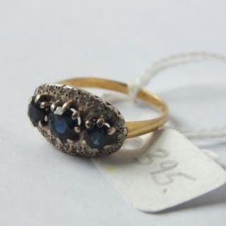 Sapphire and diamond bordered 18ct ring 5.3g. size O