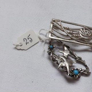 Two stylish silver brooches