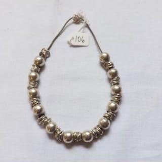 a silver bead bracelet – unmarked