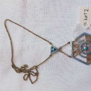 An attractive silver (800) gilt & enamel hexagonal pendant