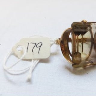Large yellow stone dress ring set in 9ct approx size K