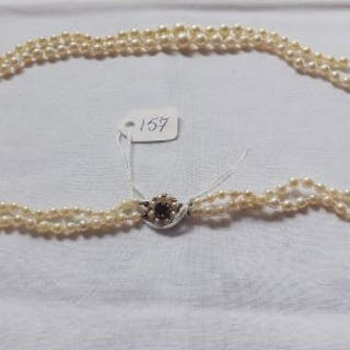 Double row of pearls with 9ct garnet set clasp