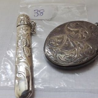Large silver scroll engraved locket and a silver needle case 26g inc