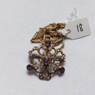 An amethyst & pearl pendant/brooch on gold chain