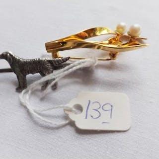A Swarovski pearl flower brooch and a silver dog brooch