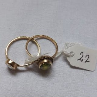 An oval peridot ring set in 9ct and another