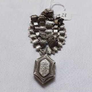 A Victorian silver hinged locket engraved silver on collar