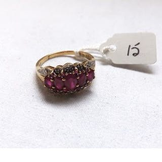 A red stone & diamond bordered ring set in 9ct