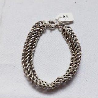 A wide silver curb link bracelet