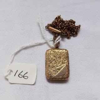 Oblong gold locket on gilt chain