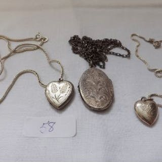 Three silver lockets on chains