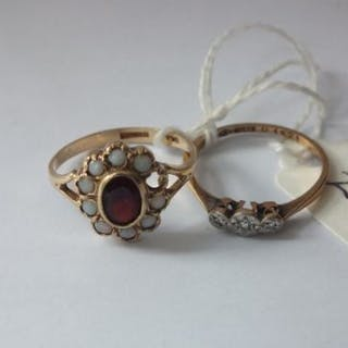 Three stone diamond ring in 9ct. and platinum and a garnet and opal