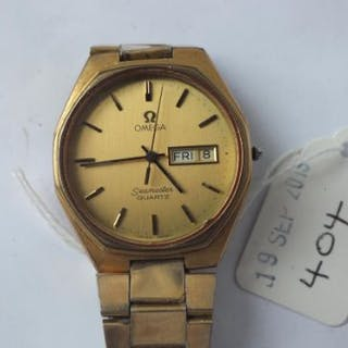 Gents OMEGA Seamaster quartz wrist watch with seconds sweep and day
