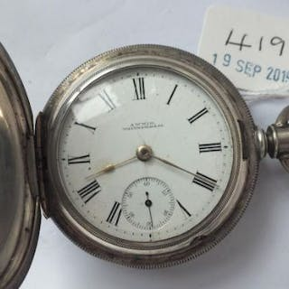 A large gents silver hunter pocket watch by Waltham with seconds dial