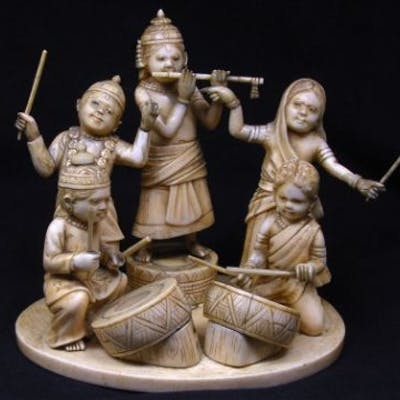 Late 19th century Indian carved ivory character group of children