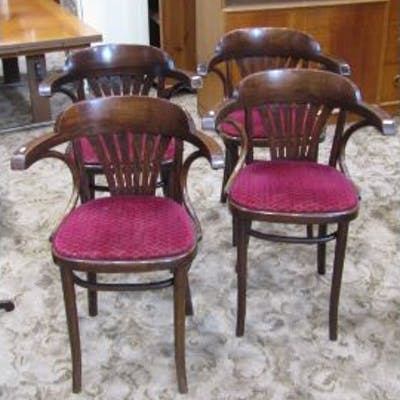 A set of four stained beechwood framed Bentwood cafe chairs with upholstered