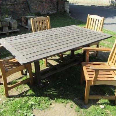 A Swan Hattersley weathered teak garden table, the rectangular slatted