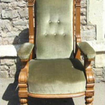 A substantial Victorian oak library or drawing room chair with Ionic