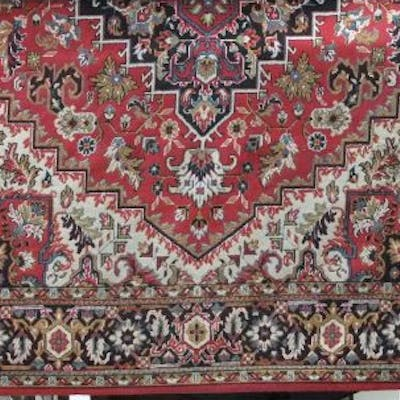 Hammadan style machine woven carpet with central navy blue floral