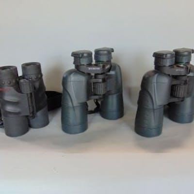 Three pairs of binoculars to include Yukon 12 x 50 and 16 x 50 and
