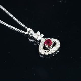 NEW OLD STOCK, Ruby and diamond pendant, circular ruby estimated weight