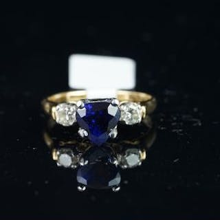 Heart shaped sapphire and diamond three stone ring, mounted in yellow