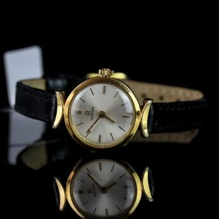 LADIES OMEGA MANUAL WIND WRISTWATCH, circular silver dial with gold
