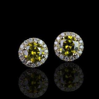 Pair of Diamond cluster earrings, set with 2 fancy intense greenish