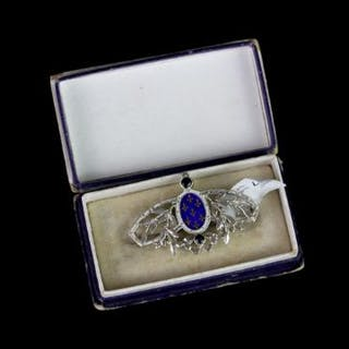 SILVER ENAMEL LATE VICTORIAN BROOCH SET WITH 2 SAPPHIRES, estimated