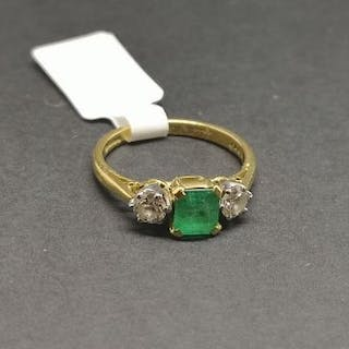 Three stone emerald and diamond ring, central square step cut emerald