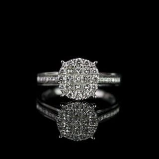 Diamond cluster ring, 9 princess cut diamonds to the centre, surrounded
