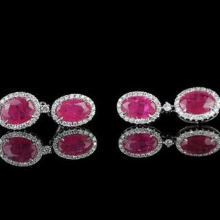 Pair of Ruby and Diamond earrings, set with 4 oval cut rubies totalling