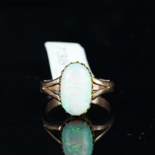 Opal dress ring, oval cabochon of opal measuring 13.85 x 8.02 x 3.30mm