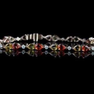 Orange and yellow sapphires and diamond bracelet, set with 22 pear