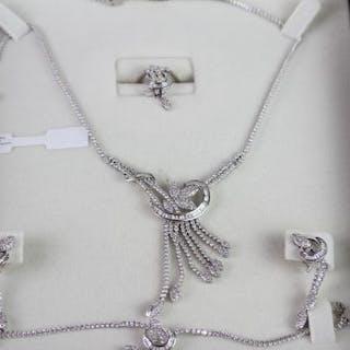 Ali Al-Haken Diamond ring, pair of earrings, bracelet and necklace