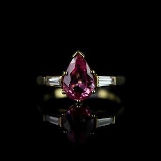 Pink sapphire & diamond set ring, pear shaped pink sapphire set to