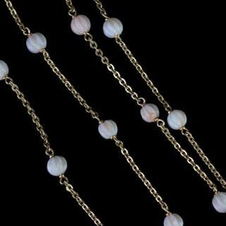 Carved coral bead necklace, 24 carved pale white/pink coral beads