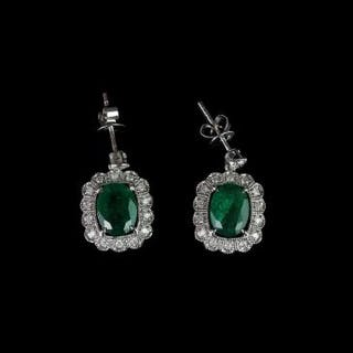 Pair of Emerald and Diamond earrings, set with 2 oval cut diamonds