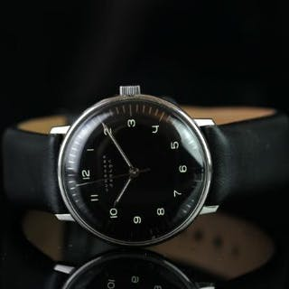 JUNGHANS DESIGN WATCH BY MAX BILL ,round , black dial with white hands
