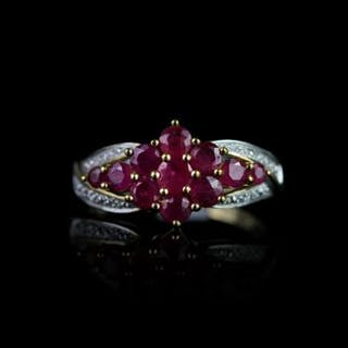 Ruby and Diamond cluster ring, set with 11 rubies in a flower shape