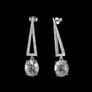 Pair of Aquamarine and Diamond earrings, set with 2 oval cut light