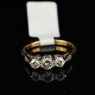 Three stone diamond ring, three round brilliant cut diamonds, weighing