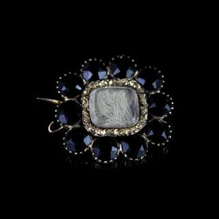 MOURNING BROOCH SET WITH JET CIRCA 1830.9ct not hallmarked, with memory
