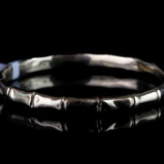 EARLY 20TH 9CT BAMBOO BANGLE,hollow, no hallmark , total weight 12gms.