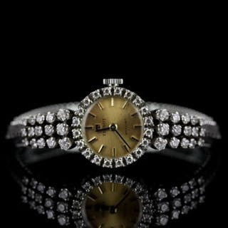 LADIES VINTAGE 14K TISSOT STYLIST WATCH.diamond set bezel and shoulders