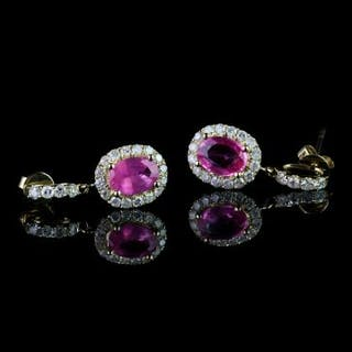 Pair of Pink Sapphire and Diamond earrings, set with 2 oval cut pink