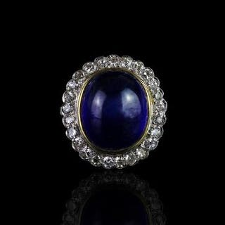 Cabochon sapphire and diamond ring, central cabochon blue sapphire