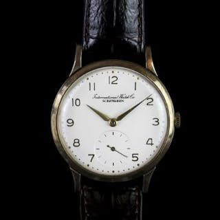 GENTLEMANS VINTAGE 9CT IWC, round,white dial with gold hands, gold